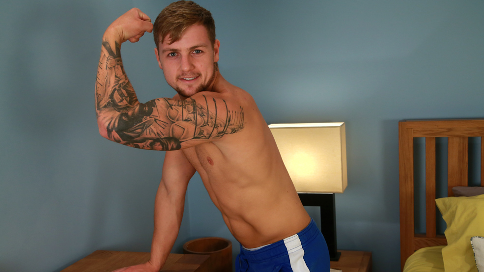 Muscular Young Personal Trainer Ralph Enjoys Flexing his Muscles & his Uncut Cock Shoots Big!