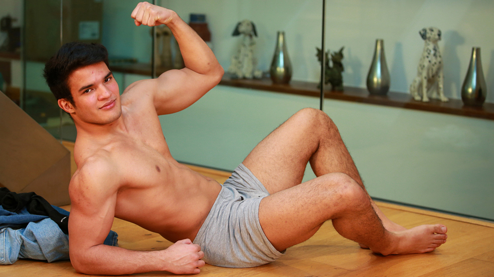 Young Athletic Wrestler Javier Shows off his Muscles and Rock Solid Uncut Erection!