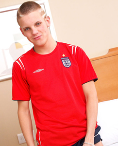 Englishlads.com: Tommie lets it all hang out of his sports kit, then spreads his legs and fingers his smooth hole